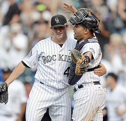 Rockies closer Rex Brothers works out of a shaky situation in the ninth and escapes with his 10th save of the season. (USATSI)