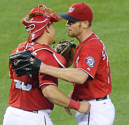 Wilson Ramos congratulates Stephen Strasburg, who achieves his first complete game of his career. (USATSI)