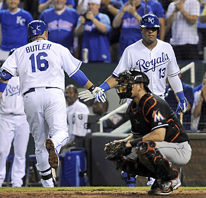 Salvador Perez congratulates Billy Butler, who homers in the seventh -- his 11th of the season. (USATSI)