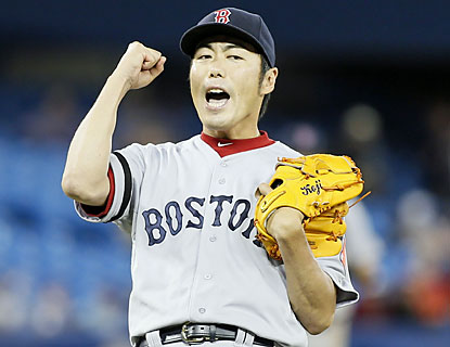 Koji Uehara (3-0) closes the door on the Blue Jays, who yield two costly runs in the top of the 11th inning. (USATSI)