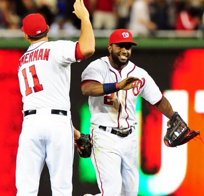 Denard Span (right) makes a diving catch in center field with two men on base to punctuate the win.  (USATSI)
