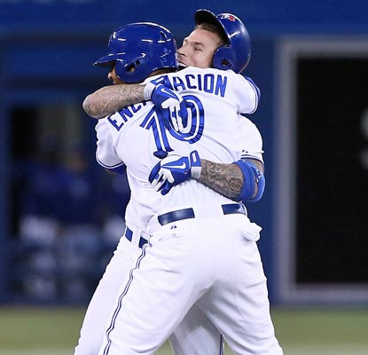 Brett Lawrie celebrates with Edwin Encarnacion after knocking in the winning run for the Blue Jays in the 10th inning.  (USATSI)
