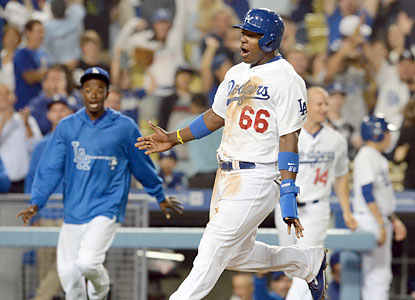Yasiel Puig, who uses a heads-up play to stretch a single into a double in the 12th, scores the winning run for LA. (USATSI)
