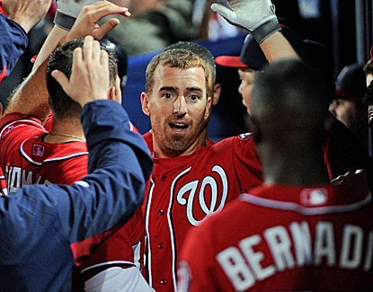 The Nationals celebrate Adam LaRoche's 15th-inning homer, which proves to be the game-winner for Washington. (USATSI)