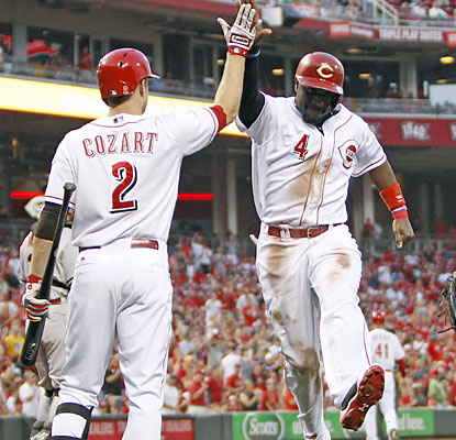 Zack Cozart greets Brandon Phillips, who finishes 3 for 4 with a triple and two runs scored. (USATSI)