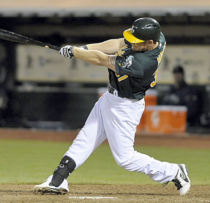 Brandon Moss ends the game with a swing. The Athletics' slugger goes deep with one out in the bottom of the ninth. (USATSI)