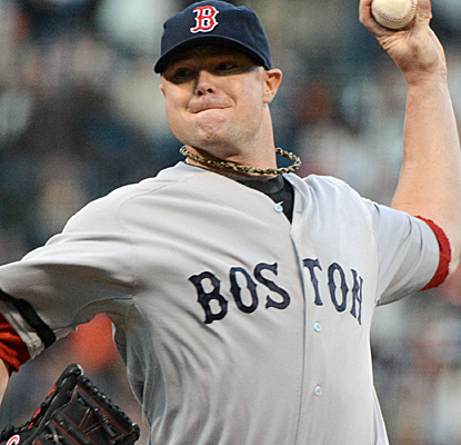 Jon Lester pitches into the ninth inning for his first August win, helping the BoSox retain first place.  (USATSI)