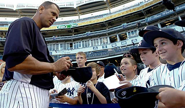 Alex Rodriguez signs autographs during what will be a long wait for a resolution in his PED case. (USATSI)