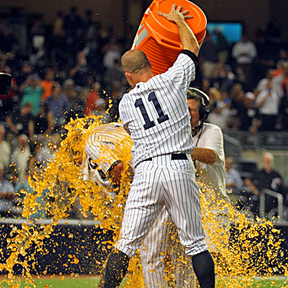 Jayson Nix (left) is doused with Gatorade by Brett Gardner after hitting the winning RBI against the Blue Jays. (USATSI)