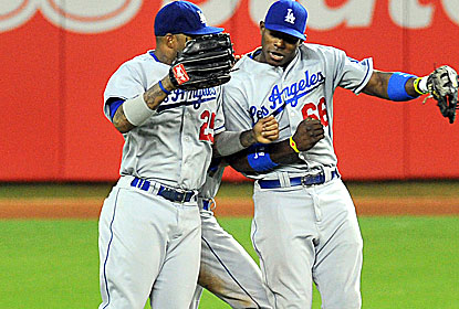 Held out of the lineup due to recent struggles, Yasiel Puig (right) -- who draws a fine for being late -- picks up LA. (USATSI)
