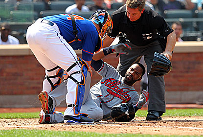 Jason Heyward goes down in a heap after taking a Jonathon Niese 90 mph fastball in the right jaw during the sixth inning. (USATSI)