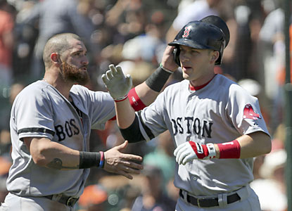 Stephen Drew (right) connects on a three-run home run to pad Boston's lead in the seventh inning. (USATSI)