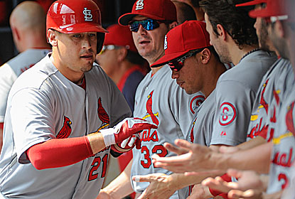 Allen Craig is a popular man in the dugout after hitting a towering HR for the Cards, who stay close in the NL Central race. (USATSI)