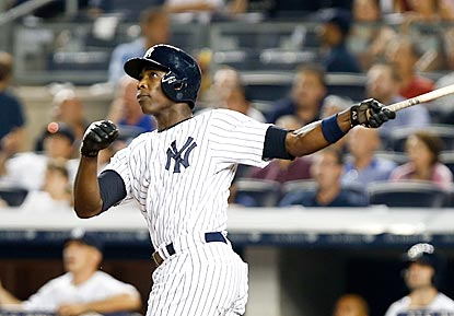 Alfonso Soriano pauses to follow the flight of his tiebreaking and decisive two-run blast in the eighth inning.  (USATSI)