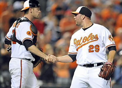 Catcher Matt Wieters congratulates Tommy Hunter, who closes out the Rays by throwing a perfect ninth inning. (USATSI)