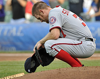 Stephen Strasburg gives up a game-tying homer in the bottom of the 9th, but his Nats' teammates pick him up in extra innings. (USATSI)