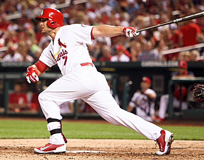 Cardinals slugger Matt Holliday breaks out of a slump with two doubles, a walk and an RBI against the Braves. (USATSI)