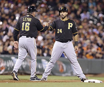 Pedro Alvarez stops at third base during the fifth inning, in which he hits a two-run double and scores.  (USATSI)