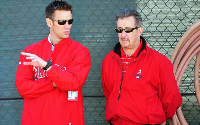Many around the Angels says Arte Moreno (right) is unhappy with GM Jerry Dipoto (left). (USATSI)