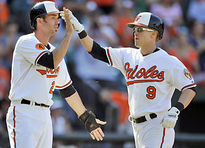 JJ Hardy and Nate McLouth (9) combine for five hits, including two homers, two doubles and five runs scored. (USATSI)