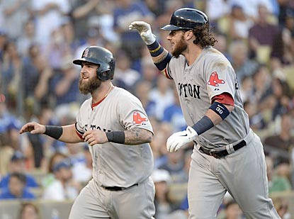 Jarrod Saltalamacchia (right) celebrates his sixth-inning home run with Mike Napoli, who adds a blast of his own in the ninth.  (USATSI)