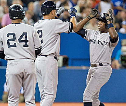 Alfonso Soriano (right) high-fives Derek Jeter after hitting the first of his two home runs in the Yankees' win over the Jays. (USATSI)