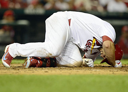 Matt Holliday shakes off fouling a ball off his leg as he ends up extending his RBI streak to seven games. (USATSI)