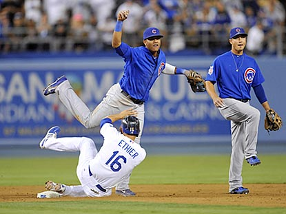 Despite Andre Ethier's slide, Starlin Castro successfully turns a double play that kills the Dodgers' rally in the eighth.  (USATSI)