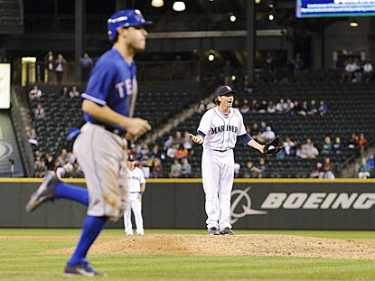Ian Kinsler jogs home with the deciding run as Danny Farquhar demands an explanation on the pivotal balk call.  (USATSI)