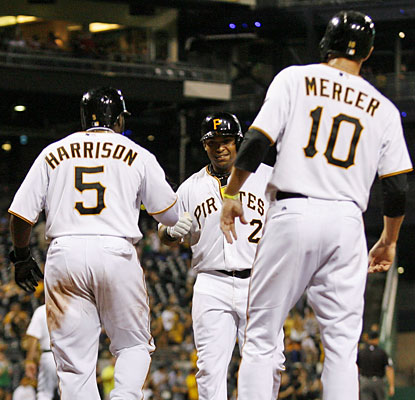 Teammates wait to congratulate new Pirate Marlon Byrd (center), who hits a three-run home run in his debut. (USATSI)