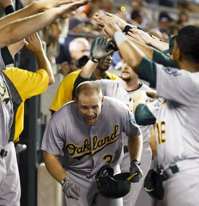 Brandon Moss drives in a career-high six RBI and is batting .450 with 10 RBI in his last six games.  (USATSI)