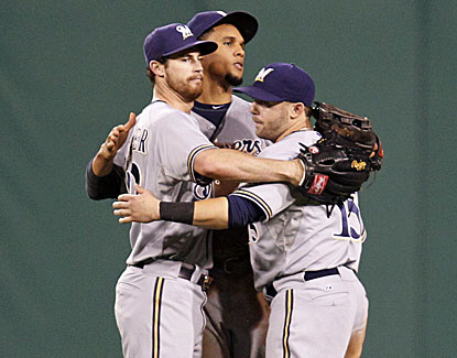 The Brewers' outfield gets together for a celebratory hug after Milwaukee shuts out Pittsburgh. (USATSI)