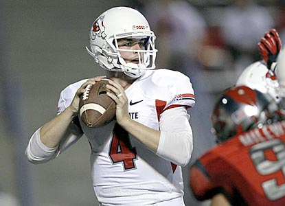 Fresno State's Derek Carr completes 53 of 74 passes for 470 yards and five touchdowns, the last in overtime.  (USATSI)