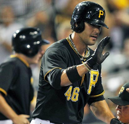 Garrett Jones smacks his 100th career home run and drives in four to help the Pirates to a key win.  (USATSI)