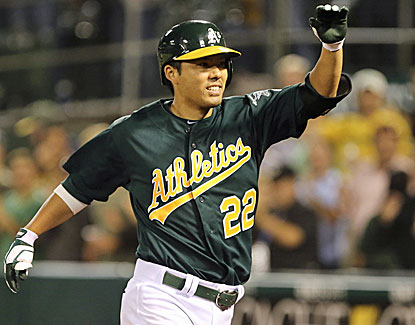 Kurt Suzuki hits a three-run homer for the A's in his first game in Oakland since being traded away last August. (USATSI)
