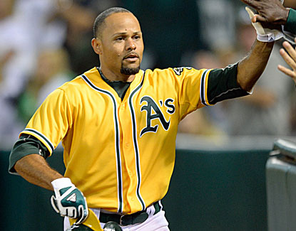 Oakland's Coco Crisp goes for three hits, including a home run, and drives in two runs against the Rays. (USATSI)