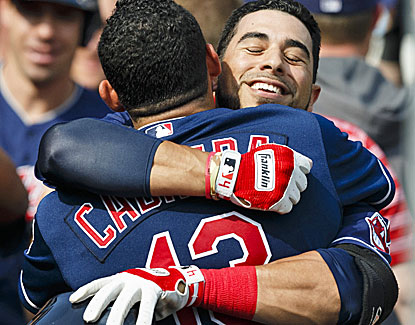 Mike Aviles and Asdrubal Cabrera share a hug after Aviles' grand slam in the ninth inning gives the Indians the lead. (USATSI)