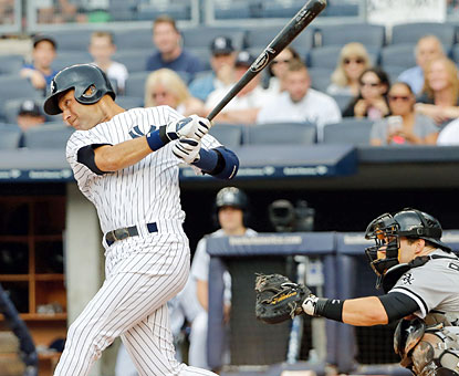 Derek Jeter breaks an 0-for-14 slide and finishes with a pair of hits and 2 RBI in the Yankees' blowout win. (USATSI)