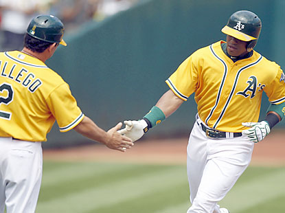 Yoenis Cespedes puts the Athletics on the scoreboard in the second inning with a solo shot off Derek Holland. (USATSI)