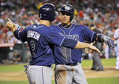 Kelly Johnson and Yunel Escobar embrace after scoring on Ben Zobrist's double in the fourth inning.  (USATSI)