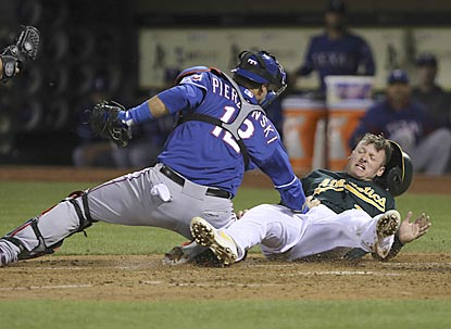 A.J. Pierzynski tags out Josh Donaldson, who tried to score from second on Yoenis Cespedes' infield single in the third inning. (USATSI)