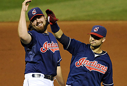 The Indians celebrate the win, one sparked by a live chicken -- owned by reliever Cody Allen -- that was taken to BP. (USATSI)
