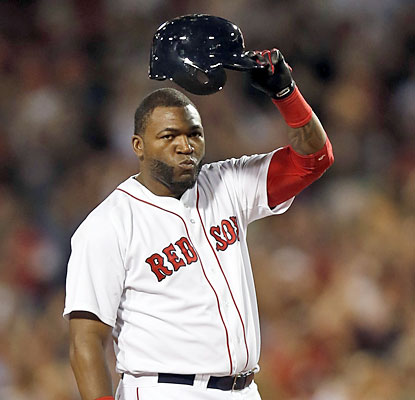 David Ortiz, who homers twice and doubles, salutes the Fenway fans after collecting his 2,000th career hit. (USATSI)