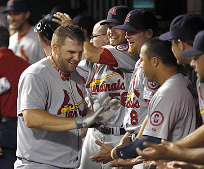 Matt Adams goes down the reception line for the second time in extra innings after his solo blast in the 16th.  (USATSI)