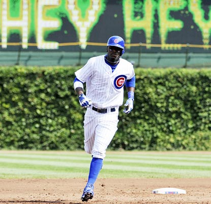 Cubs rookie Junior Lake rounds the bases in the first inning after hitting his first career grand slam.  (USATSI)