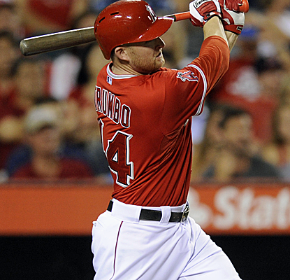 Mark Trumbo connects for a three-run homer as the Angels knock the Rangers out of first place.  (USATSI)