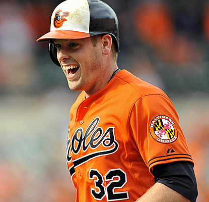 Matt Wieters is all smiles after walking the Orioles off with a two-run single in the 10th inning.  (USATSI)