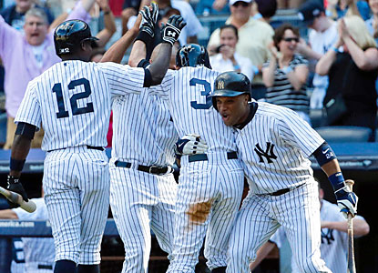 The Yankees welcome Ichiro (31) into the dugout after he scores the go-ahead run in the ninth inning. (USATSI)