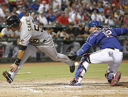 Pirates catcher Tony Sanchez scores as A.J. Pierzynski can't come up with the ball during the third inning.  (USATSI)