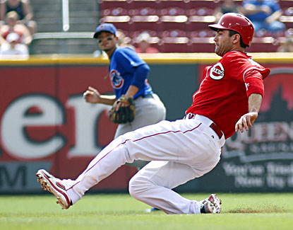 Joey Votto steals second base during the third inning of the Reds' 6-0 win over the Cubs. (USATSI)